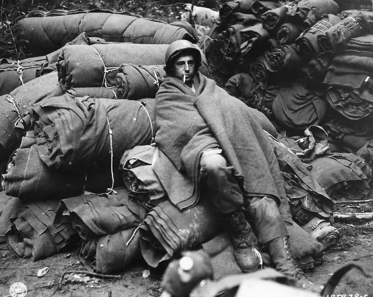 US Soldier on Bedrolls after 1st Night in Battle of the Bulge 1944