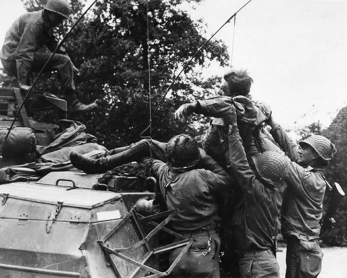 US Troops Aid Wounded German Soldier in Belgium 1944