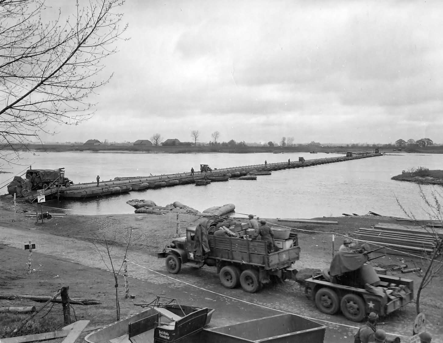 US Trucks and Quad AA Machine Guns of 8th Division Elbe River Germany 1945