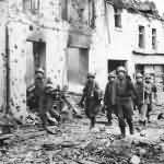 US Soldiers Advance through the streets of Weisweiler Germany 1944