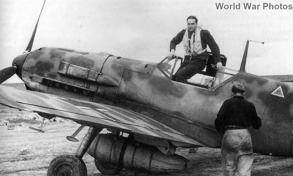 Pilot climbs out of cockpit of Bf109E