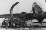A heavy gantry crane is used in changing engine on a Heinkel He111