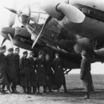 group of soldiers next to a He 111 H