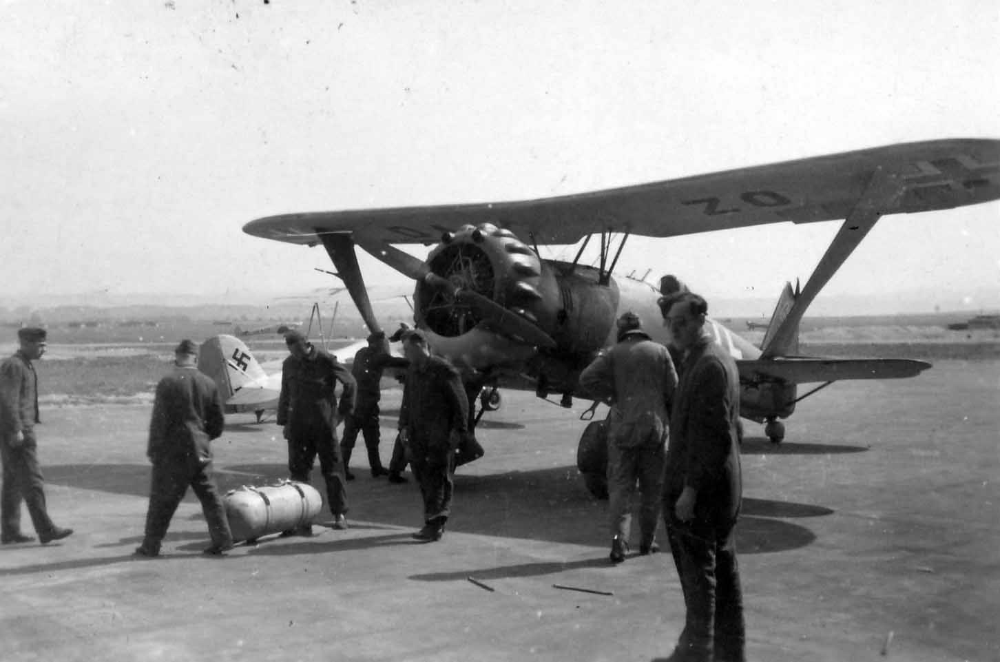 Luftwaffe ground personnel prepare to start Hs123 B