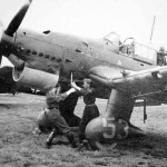 Ju87 B-1 mechanics using a hand crank to start the engine