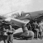 Ju87 D of StG 2. Ground crew load up a bomb on the underwing racks