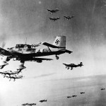 Ju87 Stuka Dive Bombers in flight over desert during World War II