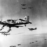 Ju87 Stuka Dive Bombers in flight over desert during World War II