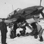 Luftwaffe ground crew loads bomb on Ju 87 B