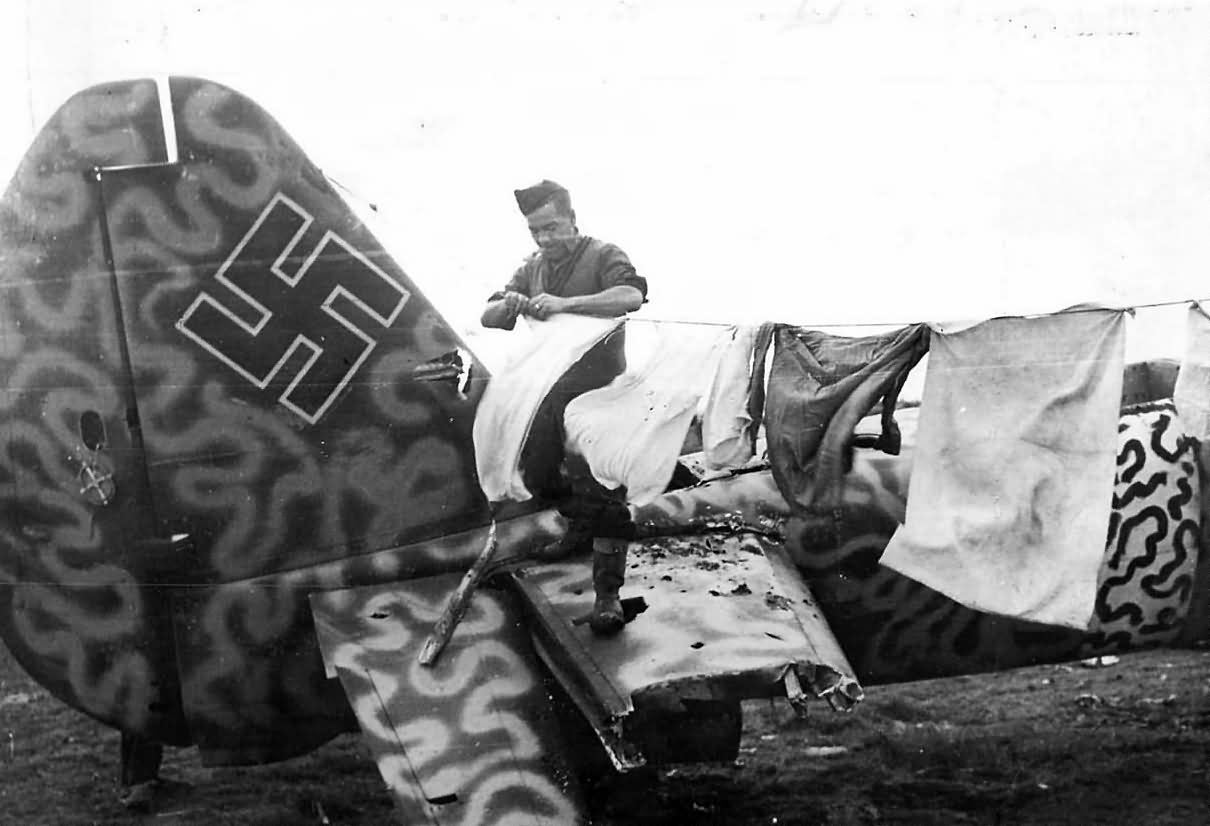 5th Army Soldier Hangs Laundry on Wrecked German Ju88 1944 Italy. Bomber with Wellenmuster wave pattern camouflage