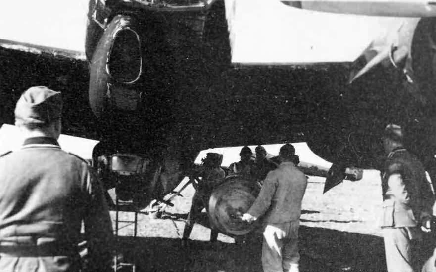 Ju88 bomber – groundcrew load up a bomb on the underwing racks