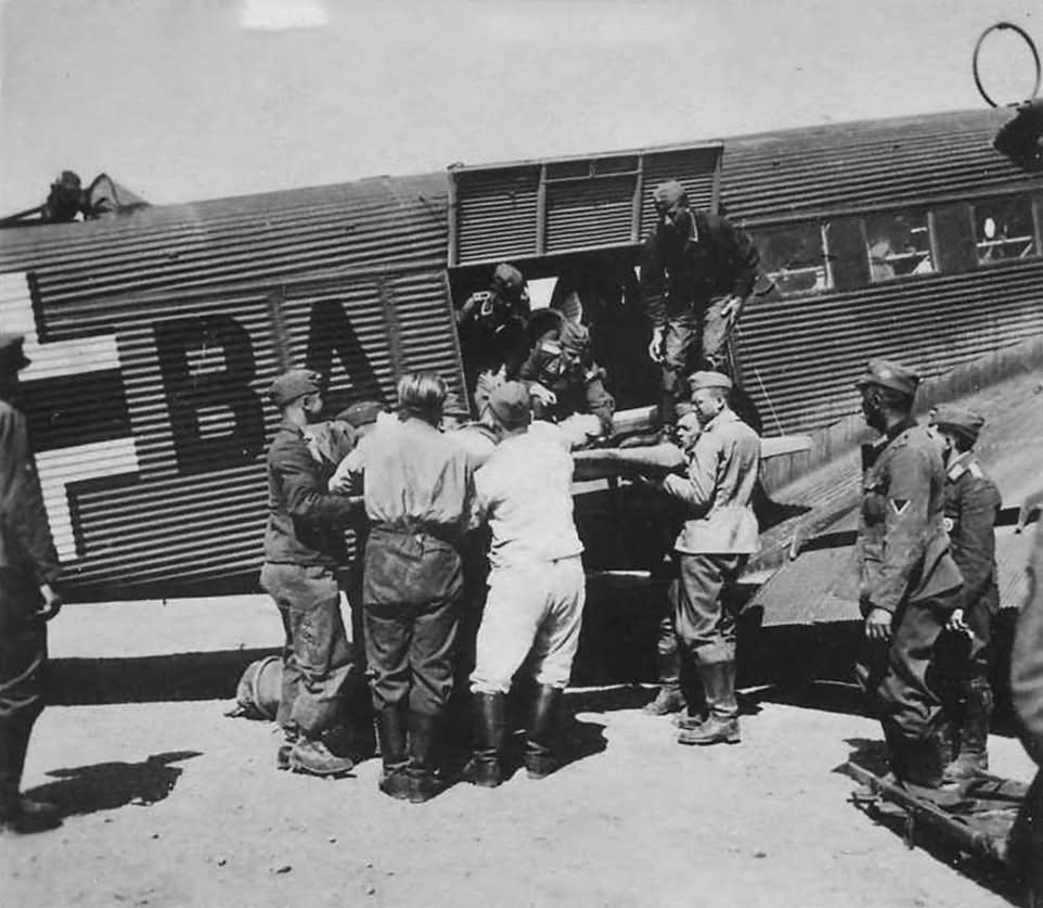 Wounded are off-loaded from a Junkers Ju 52 MEDEVAC
