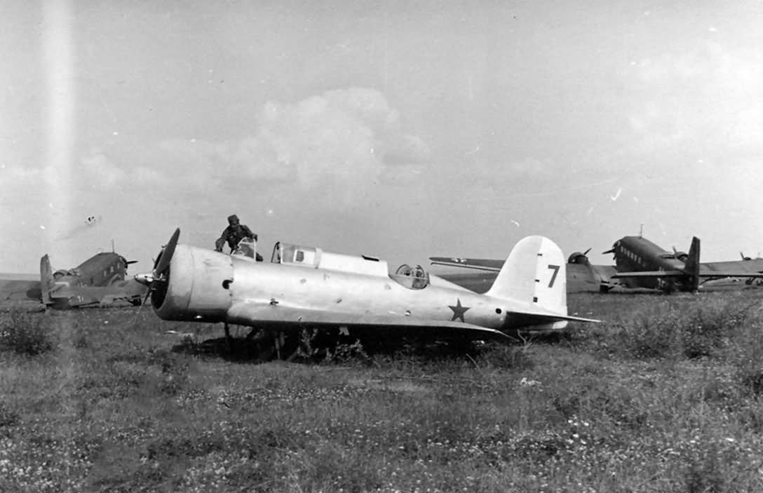 "Nieman R 10 ""7"" and Ju 52 at a captured Soviet airfield"