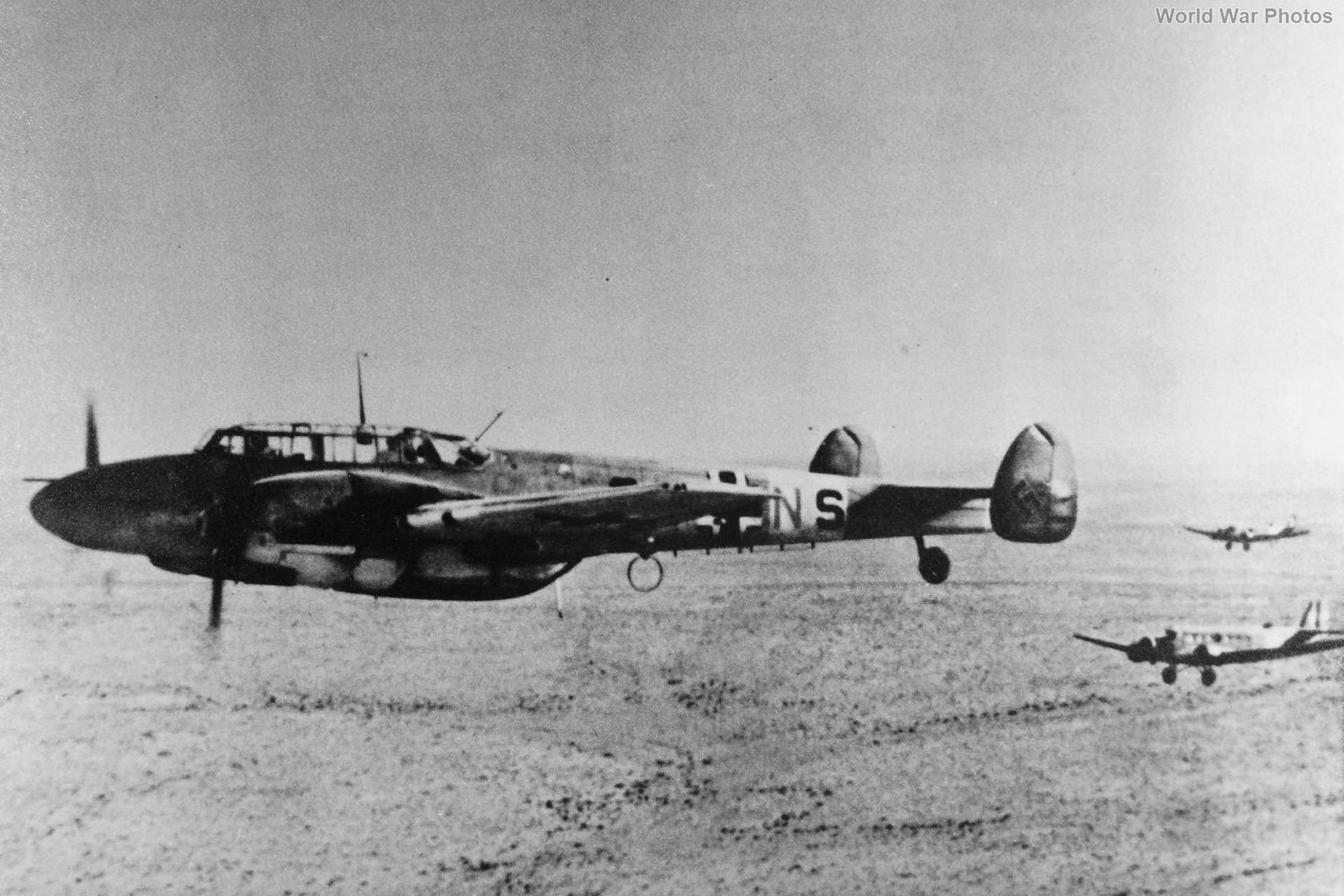 Ju 52s escorted by Bf 110 3U-NS of ZG26, North Africa