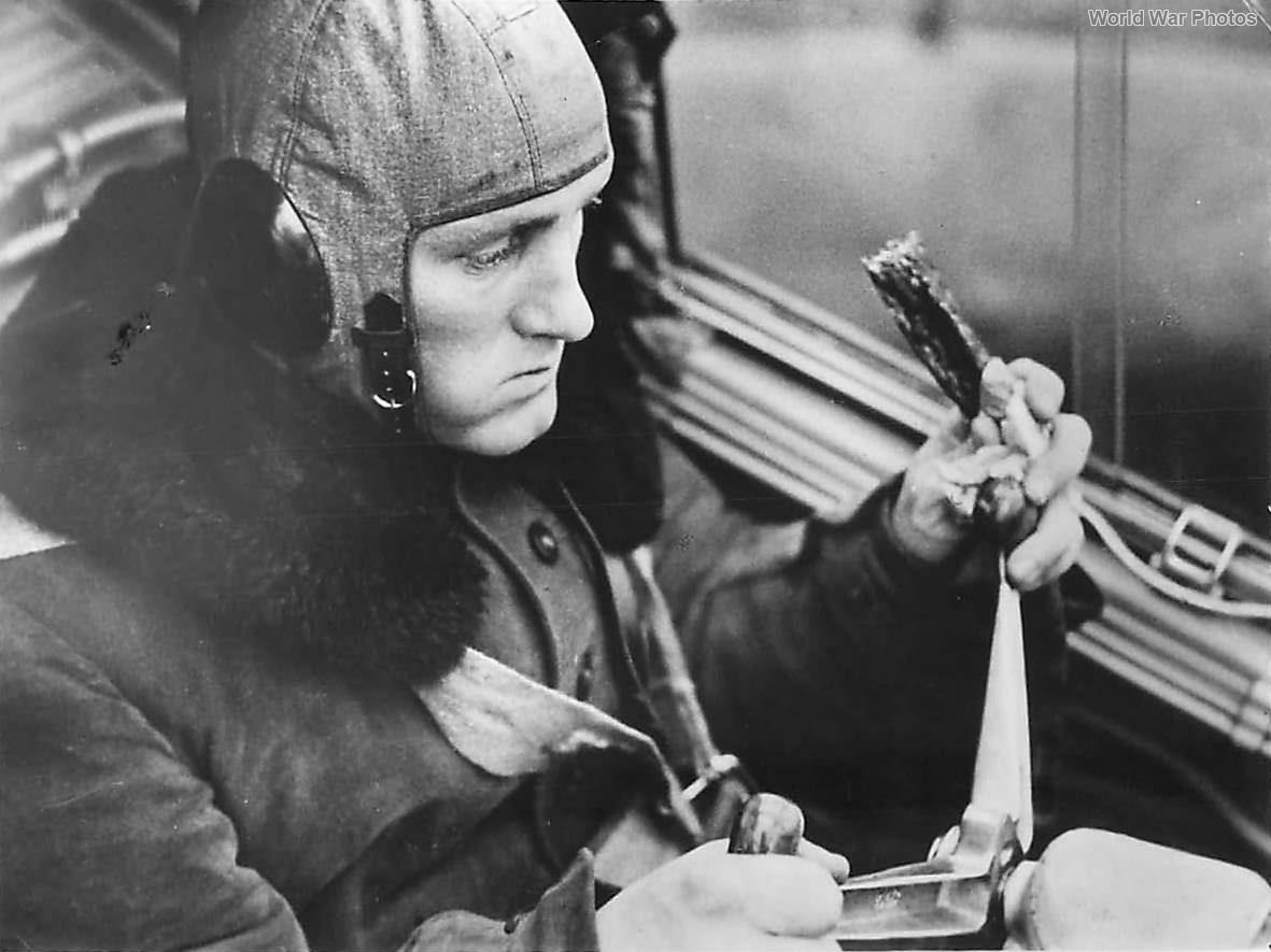 German pilot eats pemmican sausage in Bf 110 cockpit '40