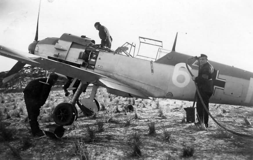 Luftwaffe mechanics at work on a Bf109E white 6 7.JG 26 in Essen Muhlheim1940