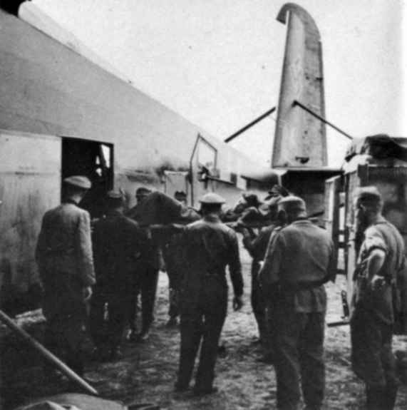 Wounded soldier being unloaded from a Me323 aircraft