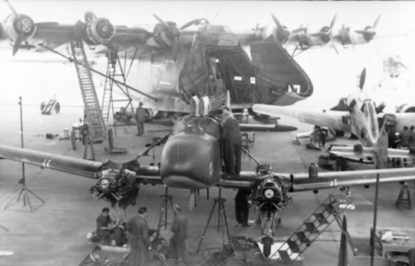 """Me323, Fw58 """"Weihe"""" and Fw190 in hangar"""