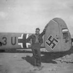 Soldier with Messerschmitt Bf110 ZG26 Africa
