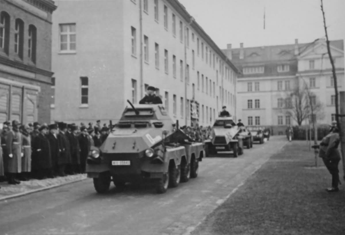 SdKfz 231 cars move along a street