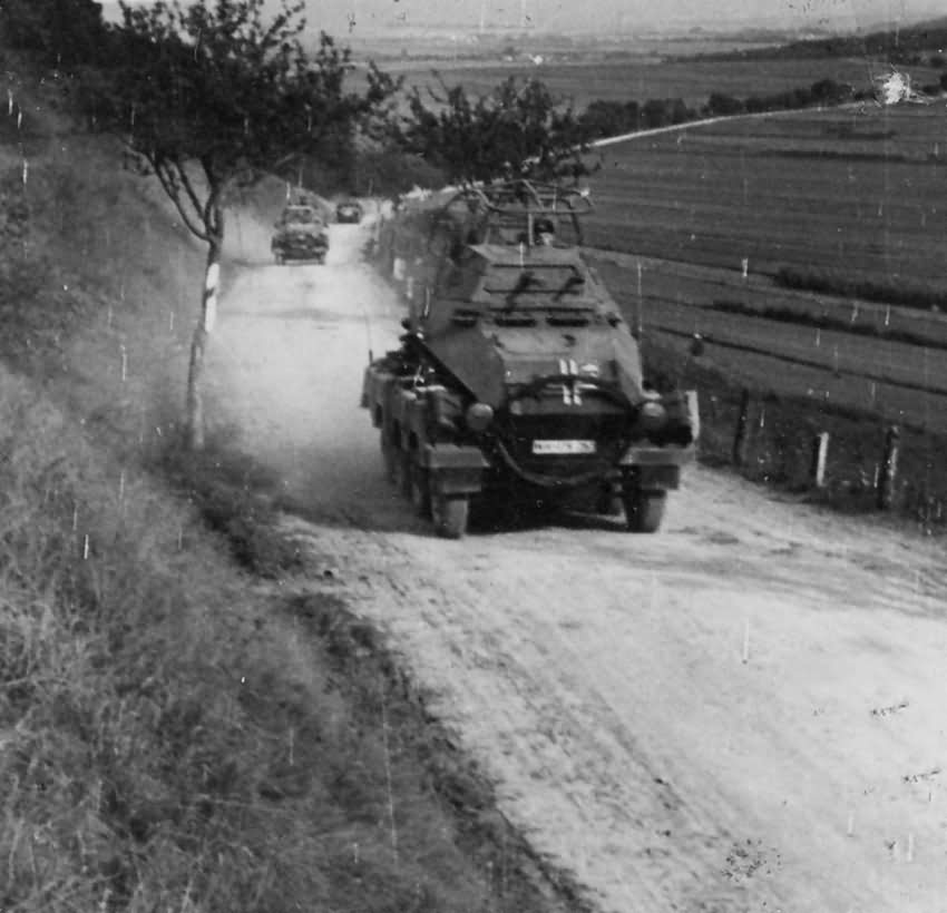 SdKfz 232 – German armored column moves along behind lines