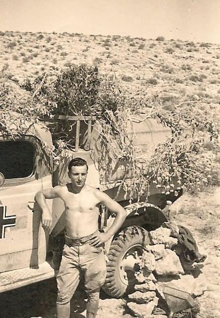 Afrika Korps Soldier with Captured British Truck