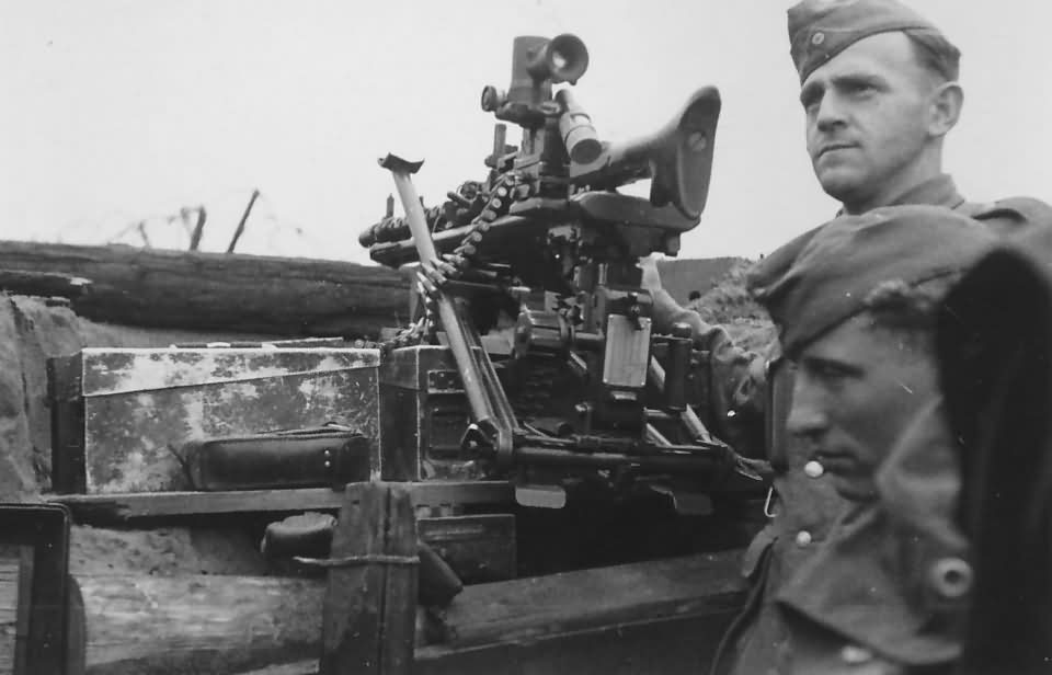 German soldiers and machine gun MG 34 with optical scope