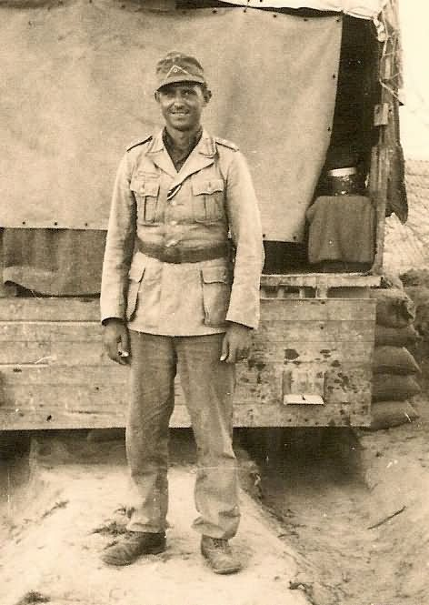 Wehrmacht Afrika Korps soldier with EKII Ribbon by Truck in Desert