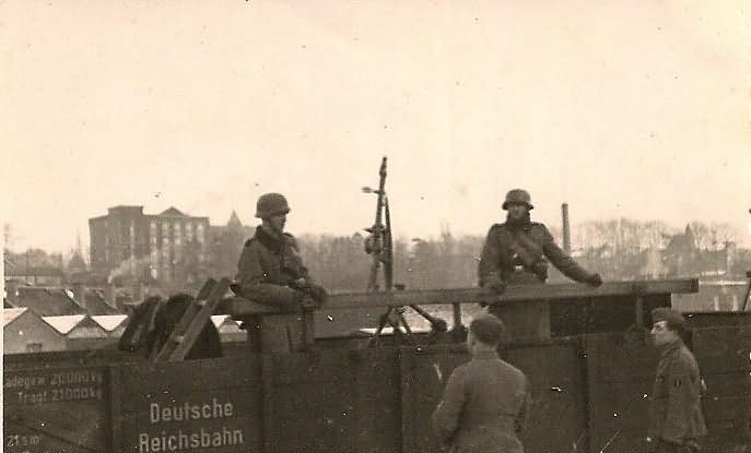 Wehrmacht Soldiers with MG34 AA Machine Gun Set Up on Railway Car