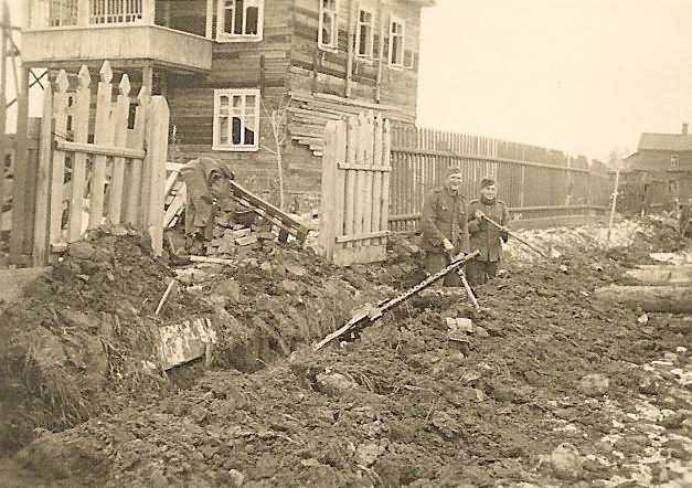 Wehrmacht Troops Digging in by Russian Town
