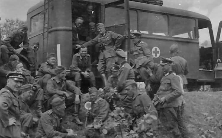 Wehrmacht Troops and Medic Bus with Red Cross