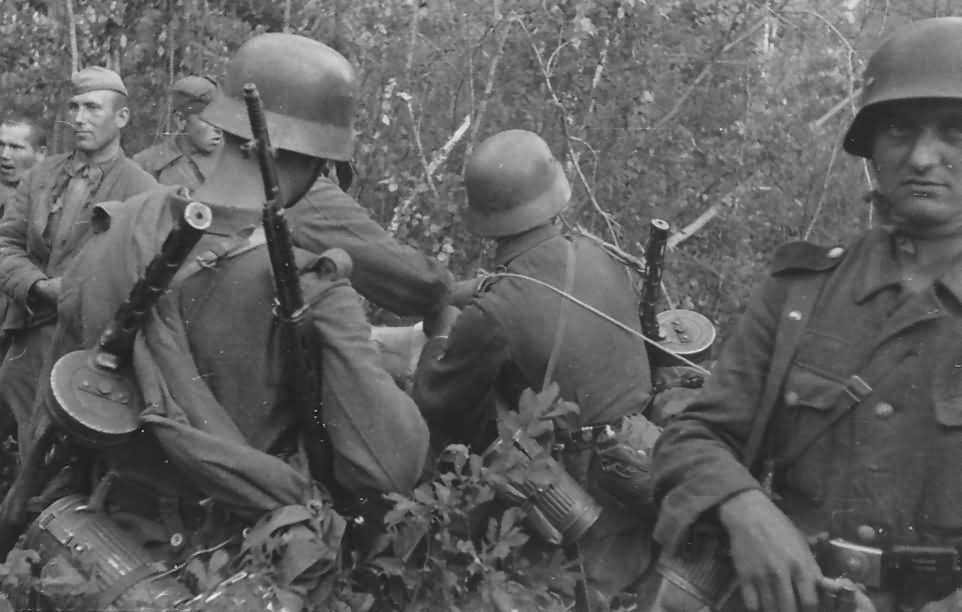 Wehrmacht soldiers with russian POW