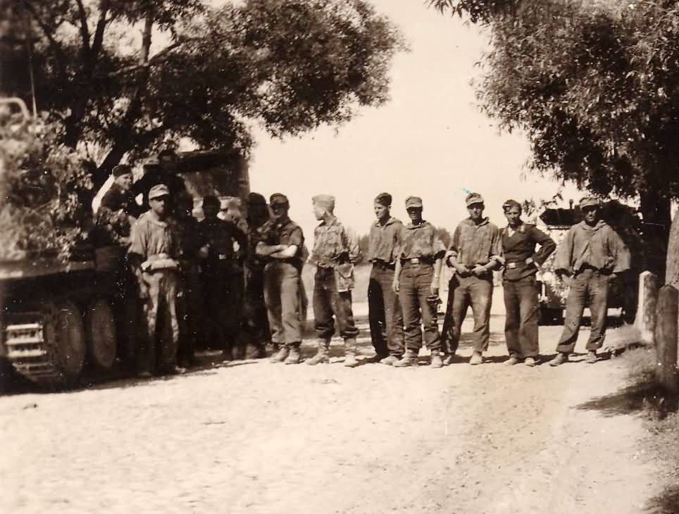 Wehrmacht soldiers lined up on the road