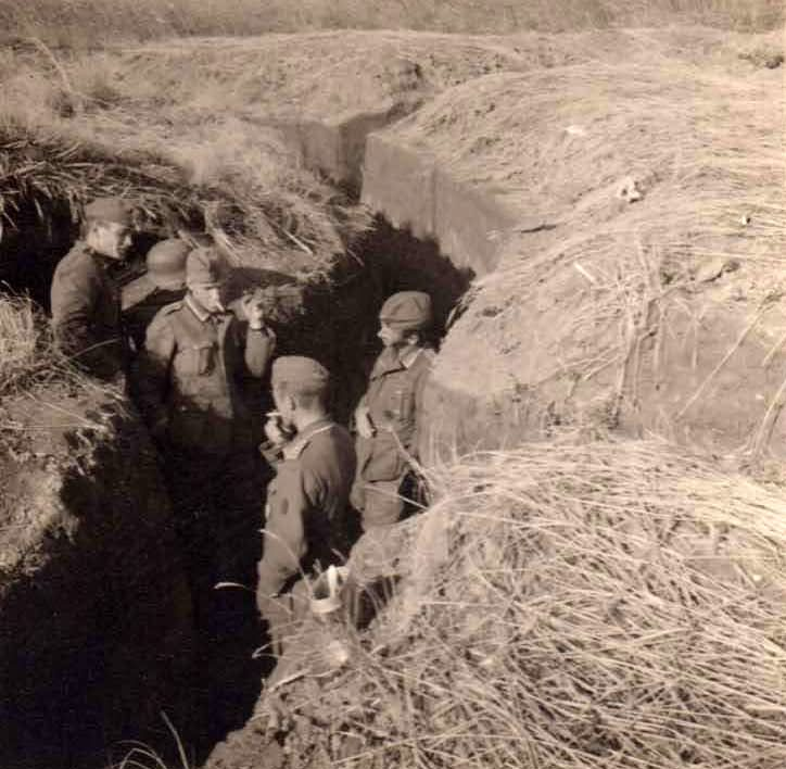 wehrmacht soldiers in trench