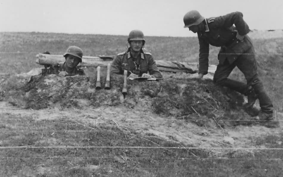 wehrmacht soldiers with handgranaten in a trench on the Eastern front