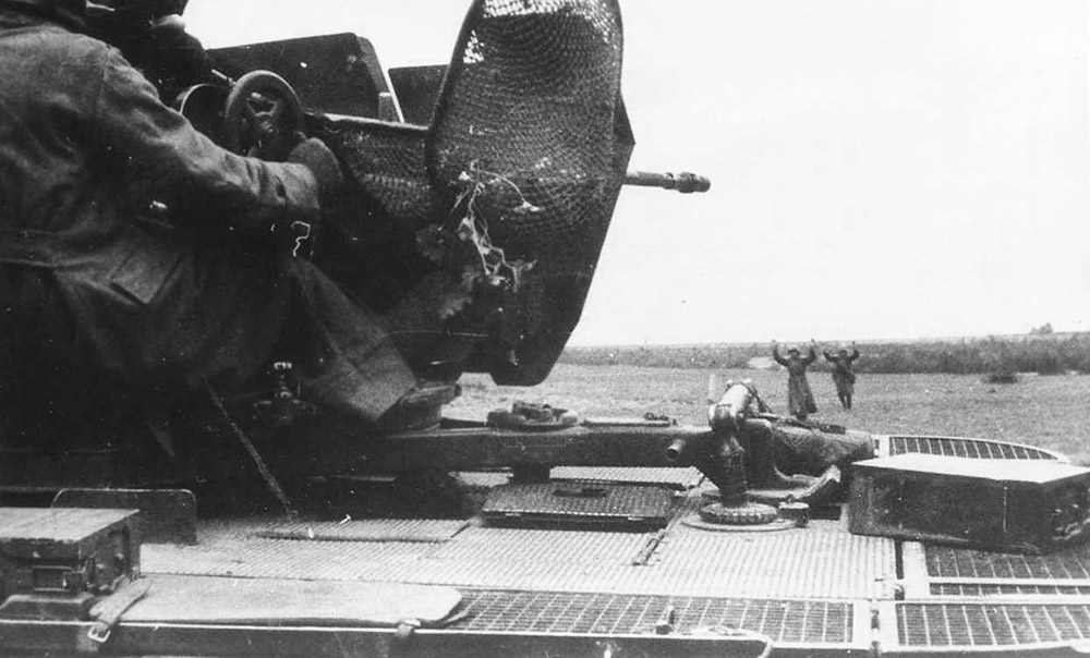 Sdkfz 10 with Flak and Russian POW