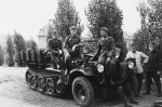 wehrmacht soldiers next to a SdKfz 10 halftrack