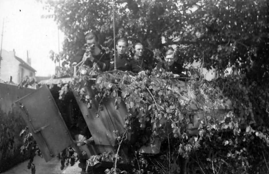 Rear view of a heavily camouflaged Sd.Kfz. 251/3 ausf D 3