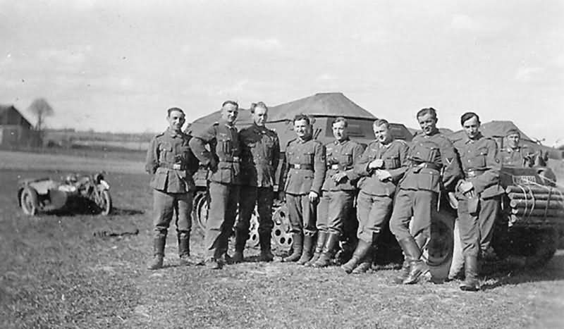 Wehrmacht soldiers with SdKfz 251 armored halftrack