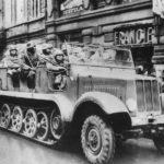 German Troops in SdKfz 6 Towing 10,5 cm leFH 18 in Prague 1939