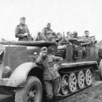 Armored SdKfz 7 towing a sFH 18
