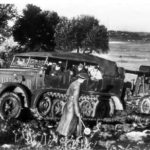 German troops use Sd Kfz 7 to tow Flak 18 gun up a hill