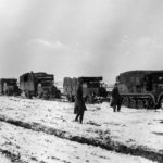 SdKfz 7 and column of German trucks Russia