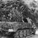 US troops atop SdKfz 7/1 of the 2.SS-Panzer-Division Das Reich in Normandy