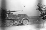 SdKfz 8 German Flak 18 (sf) Zugkraftwagen Halftrack with 88 mm gun on road