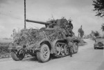 camouflaged SdKfz 8 with 88 mm Flak Halftrack France 1940