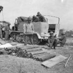 U.S. troops inspect German Shells and 16 Panzer Division SdKfz 11 in Italy
