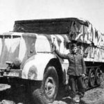 German soldier posing beside a SdKfz 9