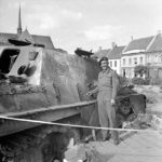 Cpl Sid Walker of the County of London Yeomanry, 7th Armoured Division next to a Jagdpanther – Gheel 16 September 1944