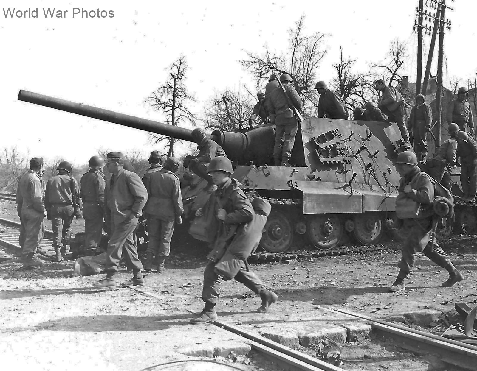 Jagdtiger 234 of the 653 sPzJgAbt and troops from U.S. 36 ID in Soultz France 18 March 1945